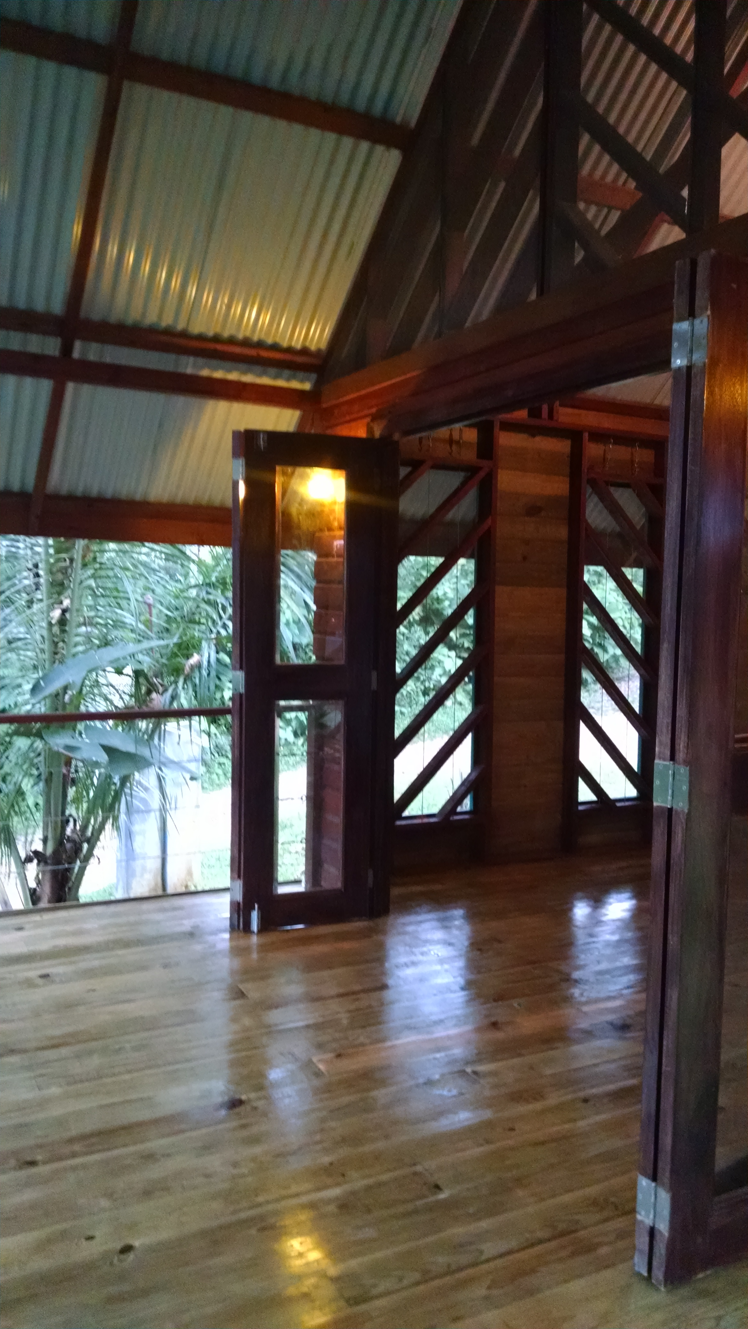 Photo of Tree Cabin deck with open doors to bedroom