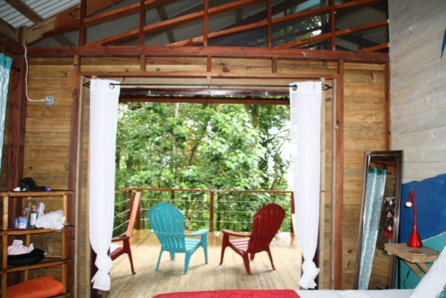 Your view out over the jungle and ocean from Tree Bungalow Left